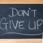 Chalk board with Don't give up written on it