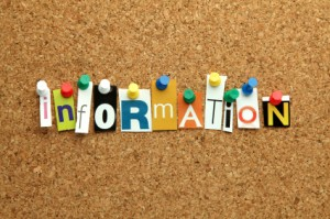 "The word ""Information"" pinned on noticeboard in cut out letters"