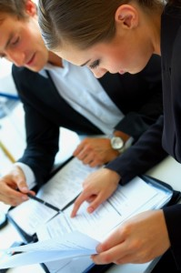 Businessman and woman looking at documents