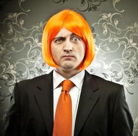 Business man in neon orange bobbed wig