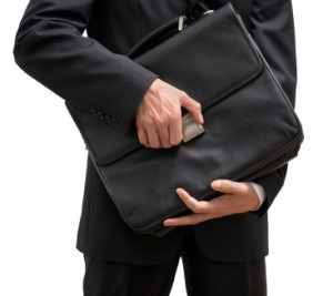 Close up of man about to open a briefcase